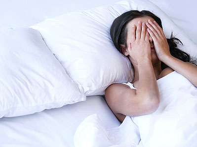 Woman worrying about not getting to sleep