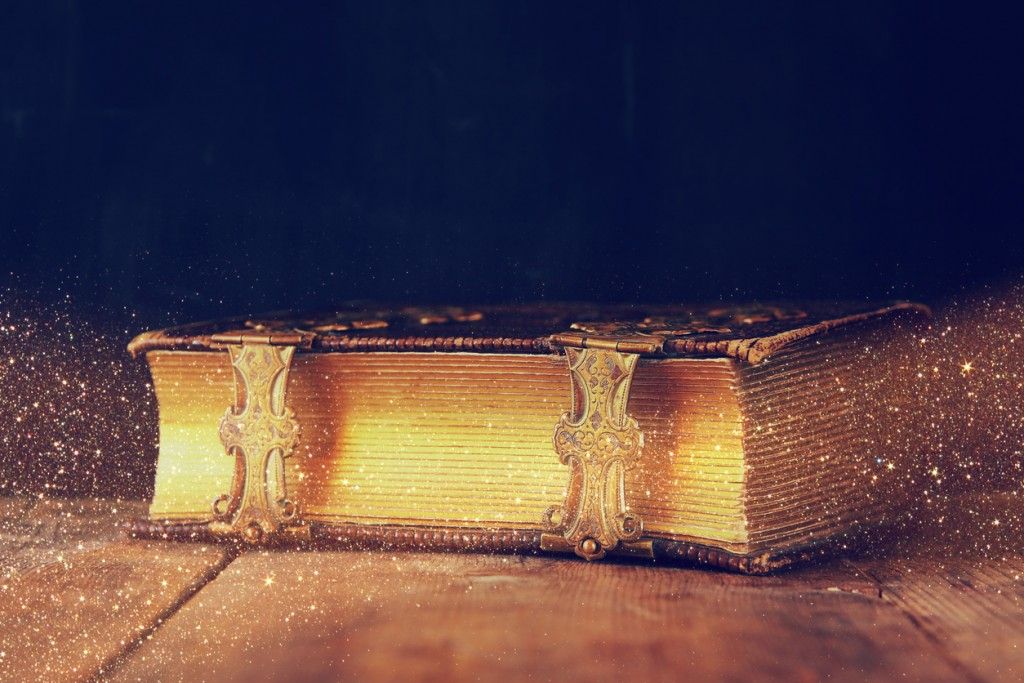 low key image of antique story book. vintage filtered. selective