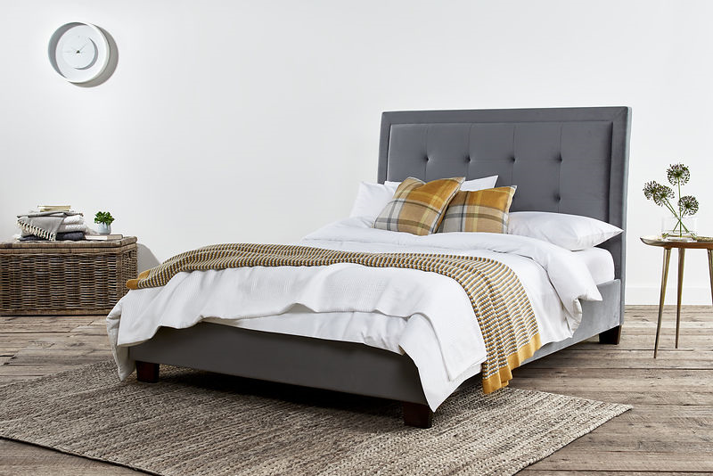 double bed in grey with yellow cushion