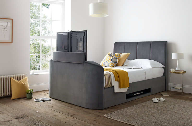 copenhagen tv bed in grey with yellow pillows